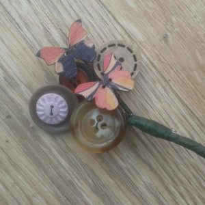 Come along and create a button brooch at our workshop