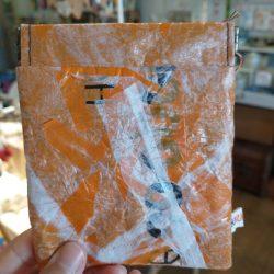 orange snap purse